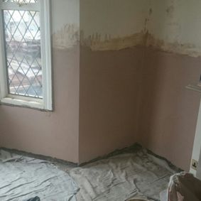A damp patch that indicates rising damp.